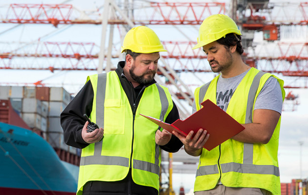 Employer and apprentice in shipyard talking