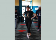 Woman participating in Māori movement class